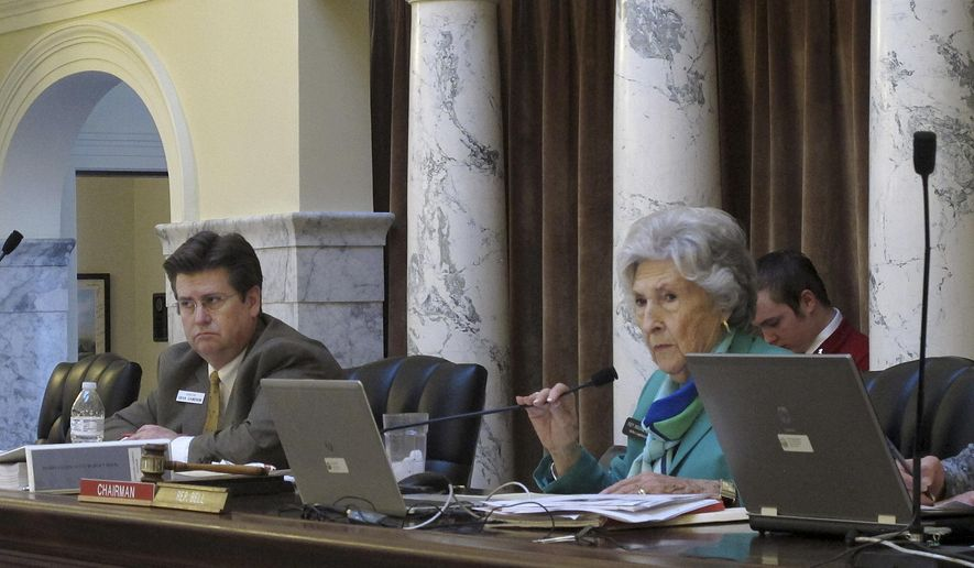 Sen. Dean Cameron, left, R-Rupert, co-chair of the Joint Finance Appropriations Committee and Rep. Maxine Bell, R-Jerome, fellow committee co-chair, listen to a budget request in Boise, Idaho on Feb. 17, 2015. The two were overseeing a request to provide enough funding to sustain Idaho's public school broadband program through the end of fiscal year 2015. (AP Photo/Kimberlee Kruesi)