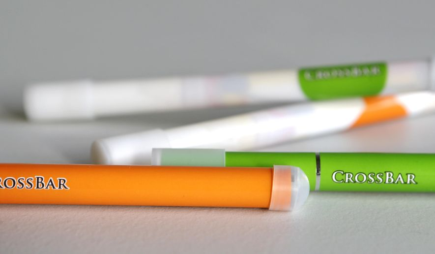 This Thursday, Feb. 12, 2015 photo shows CrossBar brand electronic cigarettes in Cleveland. Jamie Mosley, jail administrator of the Laurel County Correctional Center in London, Ky., developed the CrossBar brand of electronic cigarettes that is sold to many jails around the country. Mosley says the products are designed especially for jails and are made out of soft clear plastic to help prevent inmates from fashioning weapons out of them. (AP Photo/Tony Dejak)