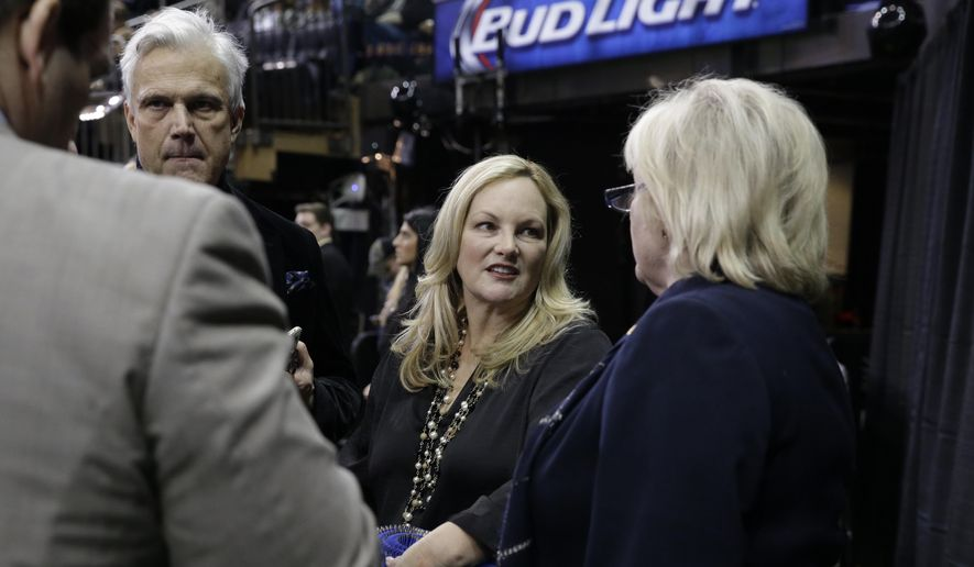 Patty Hearst, center, is seen ring side at the Westminster Kennel Club dog show, Monday, Feb. 16, 2015, at Madison Square Garden in New York. Famed and infamous heiress Patty Hearst was back in the news Monday after a dog she co-owns won its group at the Westminster Kennel Club show. (AP Photo/Mary Altaffer)