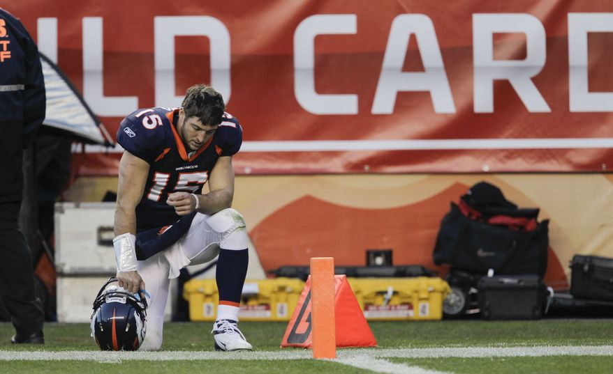 Denver Broncos quarterback Tim Tebow (15) prays on the sidelines during the third quarter of an NFL wild card playoff football game against the Pittsburgh Steelers, Sunday, Jan. 8, 2012, in Denver.  (AP Photo/Joe Mahoney)