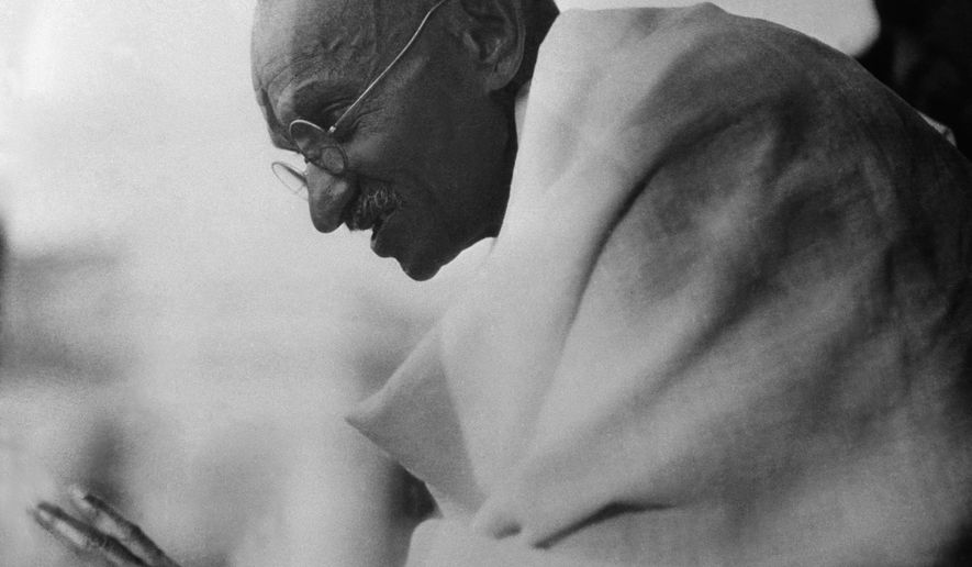 Mahatma Gandhi shown acknowledging cheers from the crowds which greeted him on his arrival after being released from prison in Poona, Jan. 20, 1931, Bombay, India. He was confined eight months. (AP Photo)