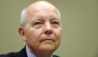 IRS Commissioner John Koskinen told Congress on Wednesday that he has had to take money away from answering phone calls and instead spend it on technology and personnel to carry out President Obama's health care law. (Associated Press)