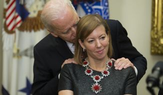 Vice President Joseph R. Biden talks with Stephanie Carter, wife of incoming Defense Secretary Ashton Carter during Carter's swearing-in ceremony,  Tuesday, Feb. 17, 2015, in the Roosevelt Room of the White House in Washington. Carter, 60, is President Barack Obama's fourth secretary of defense. (AP Photo/Evan Vucci)