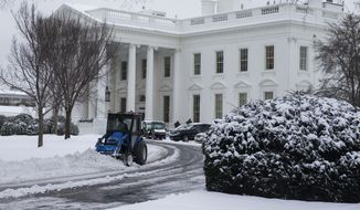 A plow removes snow from the White House driveway after a winter storm, on Tuesday, Feb. 17, 2015, in Washington. The season's first major snow storm to blast large parts of the South dropped up to 8 inches of snow around the Washington area. (AP Photo/Evan Vucci)
