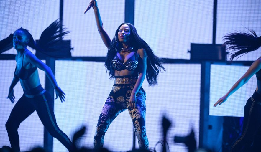 FILE - In this Sept. 19, 2014 file photo, Nicki Minaj performs at the iHeartRadio Music Festival in Las Vegas, Nev. Minaj says two members of her tour have been stabbed in Philadelphia, one of them fatally. Minaj wrote on Twitter Wednesday, Feb. 18, 2014, that the two had flown into Philadelphia for rehearsals two days ago. Philadelphia police say two men, ages 29 and 26, were stabbed early Wednesday outside a bar. They say the 29-year-old was killed and the younger man critically wounded. (Photo by Al Powers/Powers Imagery/Invision/AP, File)