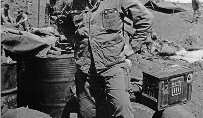 [u'WO Norm Hatch, 5th Division, USMC, Iwo Jima, February 1945', u'Maj. Norman Hatch, USMCR, (retired) one of the U.S. Marine Corps original combat cameramen, broke new ground in military cinematography by embedding with Marine units and filming them during combat. Photo of Maj. Hatch in Iwo Jima.']