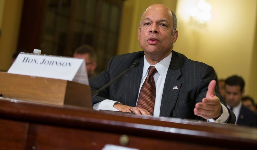 Homeland Security Secretary Jeh Johnson is ceasing preparations for a program designed to shield millions of immigrants from deportation as a result of a federal court ruling issued late Monday. Mr. Johnson said his agency will work to protect parents of U.S. citizens or legal permanent residents while the legal process continues. (Associated Press)