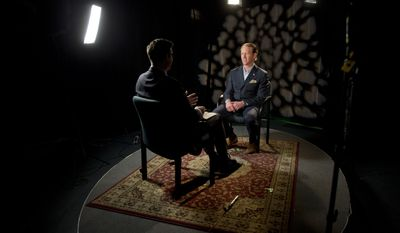 Retired Navy SEAL Robert O'Neill, 38, who says he shot and killed Osama bin Laden,  is interviewed in Washington, Friday, Nov. 14, 2014. The former Navy SEAL says he was inspired to go public about his role after meeting with the families of people who died in the attacks of Sept. 11, 2001. (AP Photo/Jacquelyn Martin)