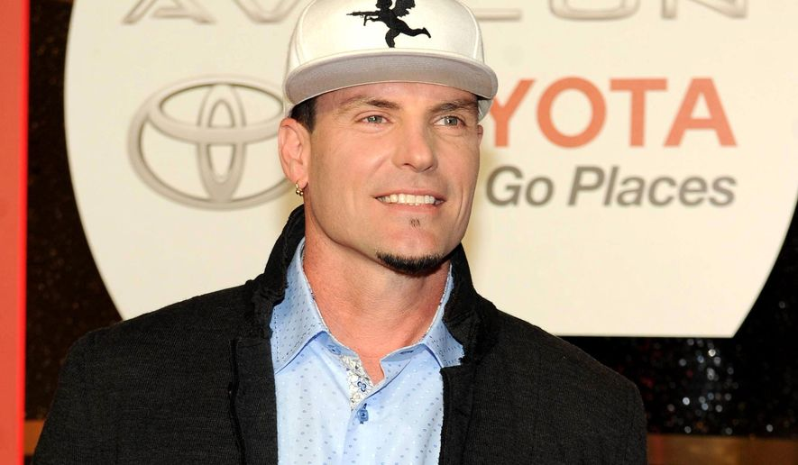 "FILE - In this Nov. 8, 2013 file photo, recording Artist Vanilla Ice arrives at the 2013 Soul Train Awards at the Orleans Arena in Las Vegas. Police in the Palm Beach County town of Lantana, Fla., say the recording artist and home-improvement-show host has been charged with breaking into and stealing from an abandoned home that is in foreclosure. They said in a news release that some of the items stolen were found at his property. Vanilla Ice, whose real name is Robert Van Winkle, rose to fame following the 1990 release of the hit song ""Ice Ice Baby."" In recent years, he has hosted ""The Vanilla Ice Project"" on DIY Network. (Photo by Frank Micelotta/Invision/AP, File)"