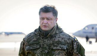 Ukrainian President Petro Poroshenko speaks to press at Borispol airport outside Kiev, Ukraine on Wednesday, Feb. 18, 2015.  **FILE**