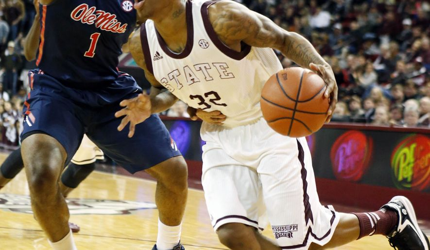 Mississippi State guard Craig Sword (32) dribbles past Mississippi guard Martavious Newby (1) in the first half of an NCAA college basketball game in Starkville, Miss., Thursday, Feb. 19, 2015. (AP Photo/Rogelio V. Solis)