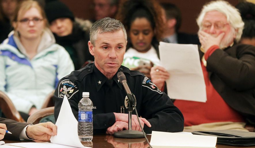 Burnsville Police Chief Eric Gieseke, center, testifies before a Minnesota Senate Judiciary Committee hearing on police body camera data classification, use and retention, Thursday, Feb. 19, 2015, at the State Capitol in St. Paul, Minn. (AP Photo/Jim Mone)