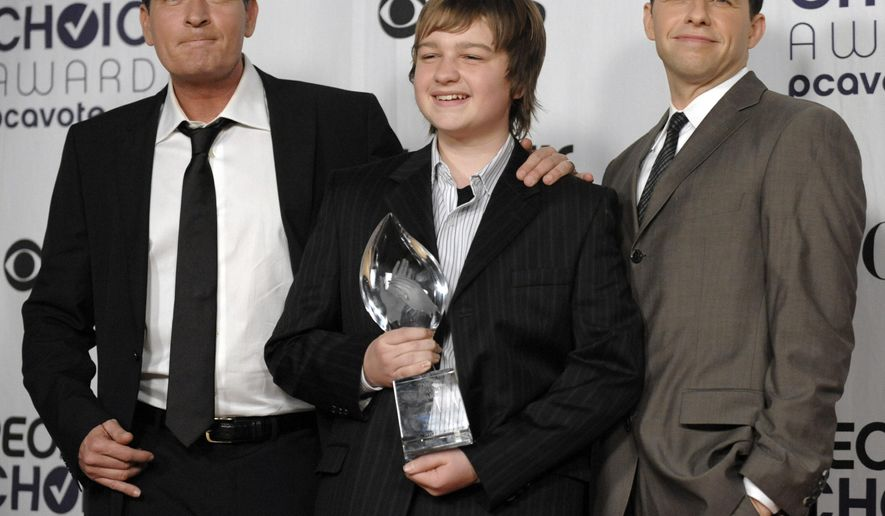"FILE - In this Jan. 7, 2009 file photo, from left, Charlie Sheen, Angus T. Jones and Jon Cryer, pose for a picture backstage with their favorite TV comedy award for ""Two and a Half Men"" at the 35th Annual People's Choice Awards in Los Angeles. There's been plenty of comedy onscreen and tons of drama behind the scenes. It all comes to an end Thursday, Feb. 19, 2015,  as ""Two and a Half Men,"" the remarkably durable hit CBS sitcom, wraps its 12-season run with a one-hour series finale. Funny or not, the conclusion will answer this burning question: Will former series star Sheen make a conciliatory guest appearance, as rumored, four years after his rancorous firing?  (AP Photo/Chris Pizzello, File)"