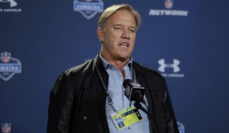 Denver Broncos executive vice president John Elway answers a question during a news conference at the NFL football scouting combine in Indianapolis, Thursday, Feb. 19, 2015. (AP Photo/David J. Phillip)