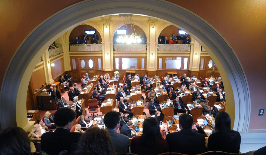 A group of South Dakota college students on Thursday, Feb. 19, 2015, at the state Capitol in Pierre, S.D. watch the state House debate on a measure they spent lobbying much of the day against that would have allowed people 21 years or older to carry a concealed weapon on the state's six public university campuses. (AP Photo/James Nord)