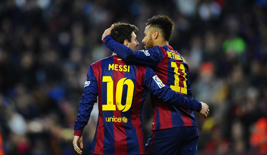 FC Barcelona's Lionel Messi, from Argentina, left, reacts after scoring with his teammate Neymar, from Brazil, against Levante during a Spanish La Liga soccer match at the Camp Nou stadium in Barcelona, Spain, Sunday, Feb. 15, 2015. (AP Photo/Manu Fernandez)
