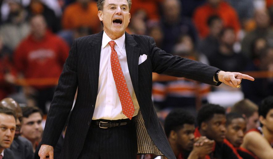 Louisville head coach Rick Pitino yells to his players in the second half of an NCAA college basketball game against Syracuse in Syracuse, N.Y., Wednesday, Feb. 18, 2015. Syracuse won 69-59. (AP Photo/Nick Lisi)