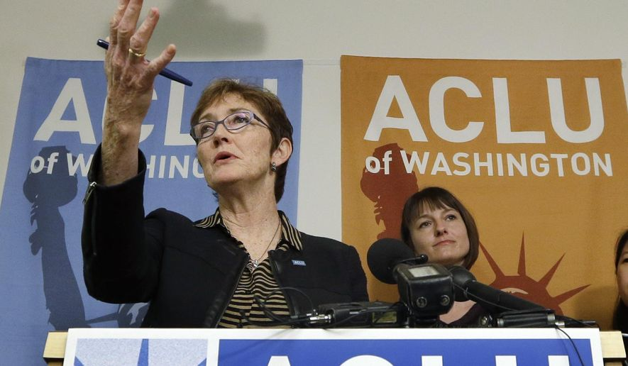Executive Director Kathleen Taylor speaks at a news conference announcing a lawsuit filed by the American Civil Liberties Union of Washington to make sure public hospitals are following the state's abortion rights law, Thursday, Feb. 19, 2015, in Seattle. The ACLU said it is suing one public hospital district Skagit Regional Health  and sending warning letters to three others over what it considers violations of the law.  (AP Photo/Elaine Thompson)