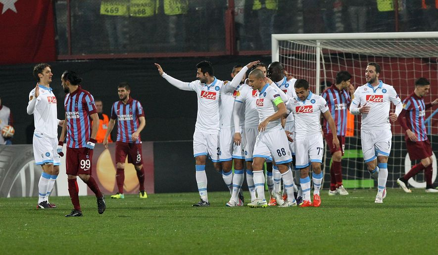 Soccer players of Napoli celebrate their goal during their Europa League Round of 32 first leg match with Trabzonspor at Avni Aker Stadium in Trabzon, Turkey, Thursday, Feb. 19, 2015. (AP Photo)
