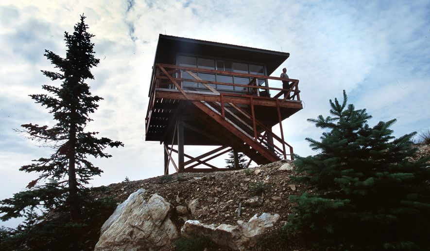 This undated photo shows Steve Christensen, Mount Spokane State Park Ranger, on a fire lookout on Quartz Mountain in Mount Spokane State Park in Washington. The fire lookout was removed from Mount Spokane in 2001 has been restored and relocated on Quartz Mountain.  (AP Photo/Rich Landers,The Spokesman-Review) (AP Photo/The Spokesman-Review, Rich Landers)  COEUR D'ALENE PRESS OUT
