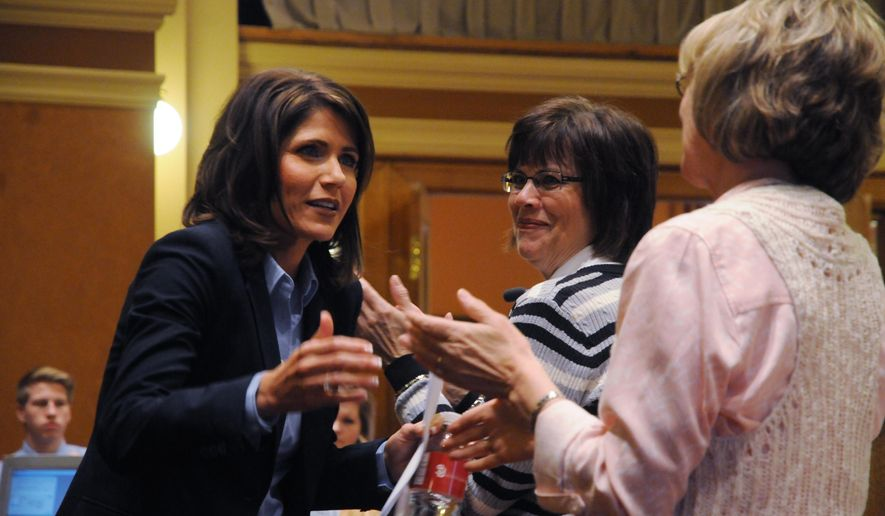 Republican U.S. Rep. Kristi Noem of South Dakota, left, greets people after a speech to state House lawmakers on Thursday, Feb. 19, 2015, in the House chamber at the state Capitol in Pierre, S.D. (AP Photo/James Nord)