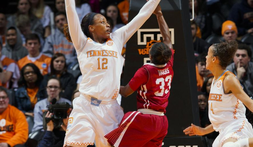 Tennessee's Bashaara Graves (12) blocks the shot of Alabama's Sharin Rivers (33) in the first half of an NCAA college basketball game Thursday, Feb. 19, 2015, in Knoxville, Tenn. (AP Photo/Patrick Murphy-Racey)