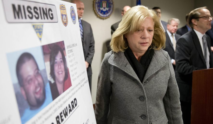 Marge Petrone, the mother of Richard Petrone Jr., walks past a poster with images of her missing son and girlfriend Danielle Imbo as FBI Assistant Special Agent in Charge Christian Zajac, right, speaks during a news conference, Thursday, Feb. 19, 2015, in Philadelphia. The FBI and local law enforcement agencies said Thursday they want to to put the 2005 disappearance of Richard Petrone Jr.and Imbo back in the public eye and encourage anyone with information about the case to come forward. A $50,000 reward is being offered in the case. (AP Photo/Matt Rourke)