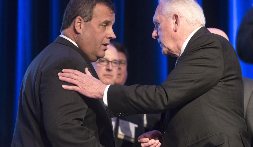 New Jersey Gov. Chris Christie, left, talks with Ray Pocino, right, before speaking at the New Jersey Chamber of Commerce's Walk to Washington and Congressional Dinner event at the Marriott Wardman Park Hotel on Thursday, Feb. 19, 2015, in Washington. (AP Photo/Kevin Wolf)