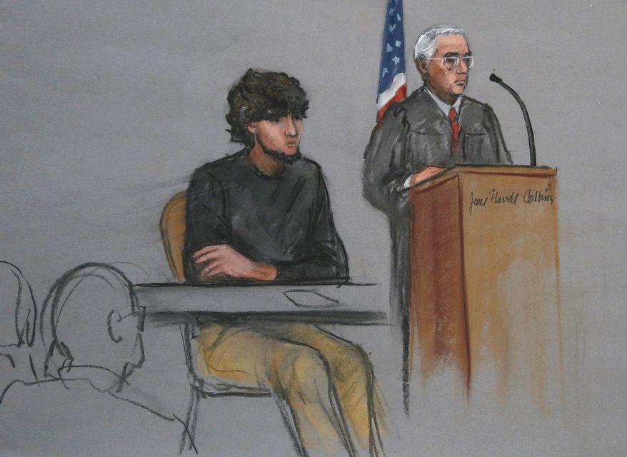 Boston Marathon bombing suspect Dzhokhar Tsarnaev, left, is depicted beside U.S. District Judge George O'Toole Jr., right, as O'Toole addresses a pool of potential jurors in a jury assembly room at the federal courthouse, in Boston, in this Jan. 5, 2015, file photo. (AP Photo/Jane Flavell Collins, File)