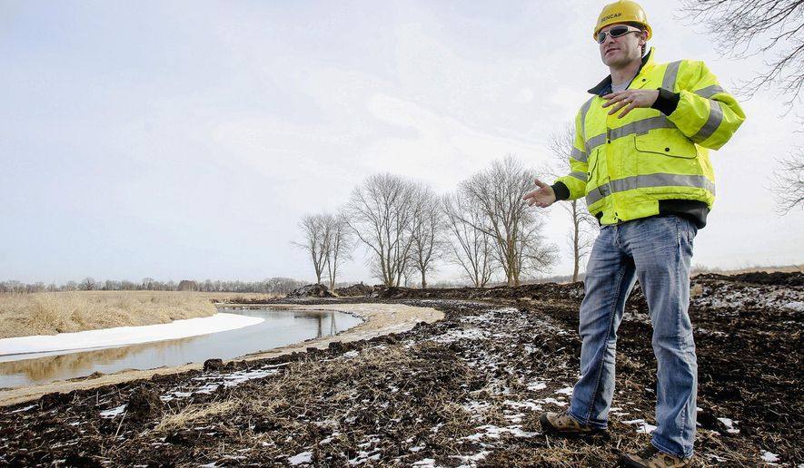 In this Jan. 28, 2015 photo, Jonathan Koepke, vice president and general manager of ENCAP, Inc., talks about eroded banks and the joint project between the McHenry County Conservation District and the U.S. Army Corps of Engineers to restore 3.5 miles of Nippersink Creek and and 507 acres of prairies and wetlands in Ringwood, Ill. (AP Photo/Northwest Herald, Sarah Nader)  CHICAGO TRIBUNE OUT, MANDATORY CREDIT