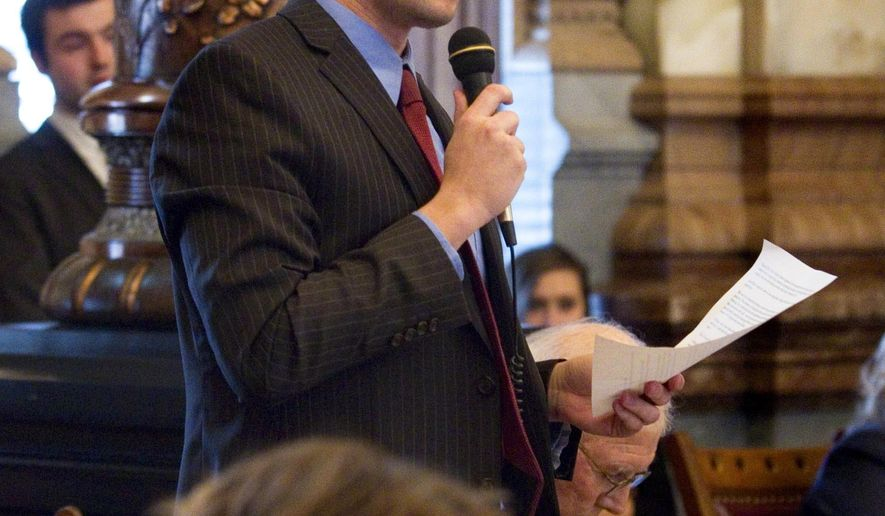 Sen. Garrett Love, R- Montezuma carried Senate Bill 95 on the floor of the Senate Thursday, Feb. 19, 2015. The Senate endorsed the bill that would out law a method of abortion relied upon to perform less than 10 percent of the procedures in Kansas, while critics of the bill guaranteed constitutional challenges in the future. (AP Photo/Topeka Capital-Journal, Thad Allton)