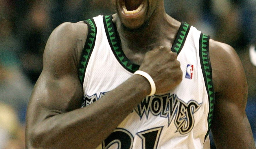 FILE - In this Nov. 25, 2006, file photo,  Minnesota Timberwolves forward Kevin Garnett pumps his fist to his chest before the start of the basketball game against the Los Angeles Clippers in Minneapolis. Garnett is coming back to the place it all began. A person with knowledge of the deal says the Minnesota Timberwolves are sending forward Thaddeus Young to the Brooklyn Nets for Garnett. The person spoke Thursday, Feb. 19, 2015,  on condition of anonymity because the deal had not been officially announced. (AP Photo/Andy King, File)