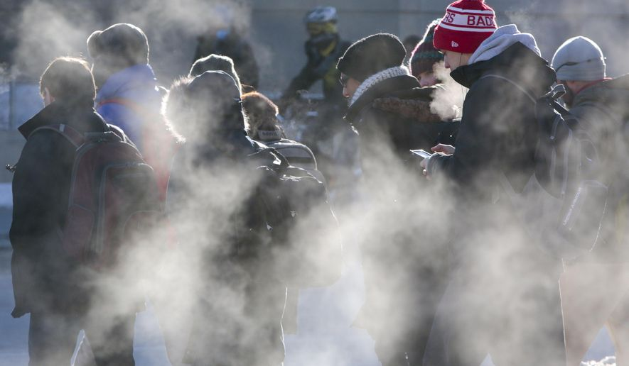 Students cross the intersection of University Avenue and North Park Street in cold weather on the University of Wisconsin-Madison campus in Madison, Wis., Thursday, Feb. 19, 2015. (AP Photo/Wisconsin State Journal, M.P. King)