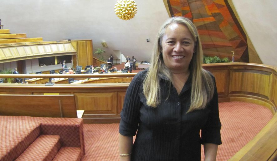 Lynn DeCoite poses in the gallery above the Hawaii House of Representatives on Thursday, Feb. 19, 2015, in Honolulu. DeCoite was appointed by Gov. David Ige to represent Molokai, Lanai and parts of Maui after Rep. Mele Carroll resigned for health reasons. Carroll passed away Wednesday. (AP Photo/Cathy Bussewitz)