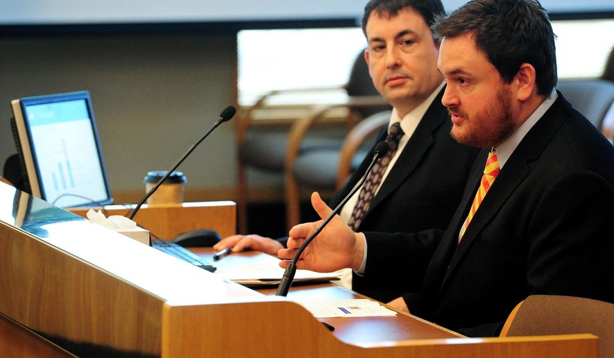 Economist Josh Lehner, right, and State Economist Mark McMullen deliver a quarterly revenue outlook during a Senate Committee on Finance and Revenue on Thursday,  Feb. 19, 2015, in Salem, Ore.  (AP Photo/Statesman-Journal, Brent Drinkut)