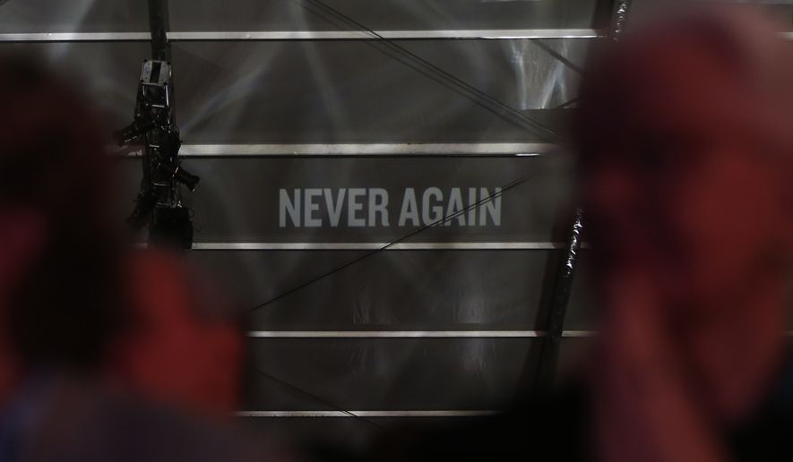 "The words ""Never Again"" are projected onto the ceiing of a tent during an event marking the 20th anniversary of the United States Holocaust Memorial Museum in Washington, Monday, April 29, 2013. (AP Photo/Charles Dharapak)"