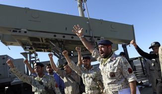 Iranian navy personnel celebrate after successfully launching a Ghader missile from the Jask port area on the shores of the Sea of Oman during a drill, Tuesday, Jan. 1, 2013. Iran says it has tested advanced anti-ship missiles in the final day of a naval drill near the strategic Strait of Hormuz, th(...)