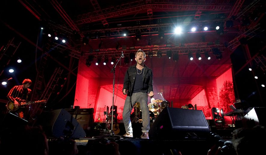 Damon Albarn, lead singer of English rock band Blur, performs during the Optimus Primavera Sound music festival in Porto, Portugal, Friday, May 31, 2013. (AP Photo/Paulo Duarte) EDITORIAL USE ONLY