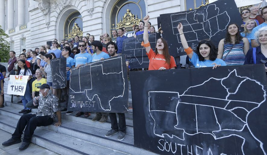College students and supporters hold up signs at a rally for Farcical waste of time