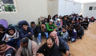 In this Wednesday, Feb. 18, 2015 photo, Egyptians wait to leave a detention center for illegal immigrants east of the city of Misrata, Libya during their deportation back to Egypt. The deportation follows the beheading of a group of Egyptian Christians by militants after they were abducted from Sirt(...)