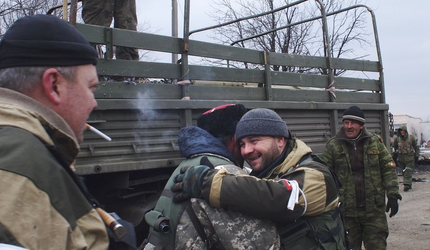 A pro-Russia rebel cossack, second left, hugs another rebel in Debaltseve, eastern Ukraine, Thursday, Feb. 19, 2015. After weeks of relentless fighting, the embattled Ukrainian rail hub of Debaltseve fell Wednesday to Russia-backed separatists, who hoisted a flag in triumph over the town. The Ukrain(...)