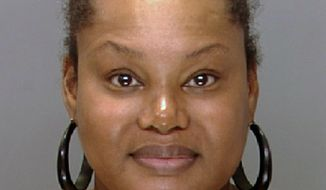"FILE - This undated file photo provided by the Philadelphia Police Department shows Padge Gordon, also known as Padge Victoria Windslowe. An aspiring rapper known as ""the Black Madam,"" Windslowe is accused of killing a 20-year-old dancer from London during a procedure that involved silicone buttocks injections and Krazy Glue.  Her third-degree murder trial is expected to start Thursday, Feb. 19, 2015 in Philadelphia Common Pleas Court.  (AP Photo/Philadelphia Police Department, File)"
