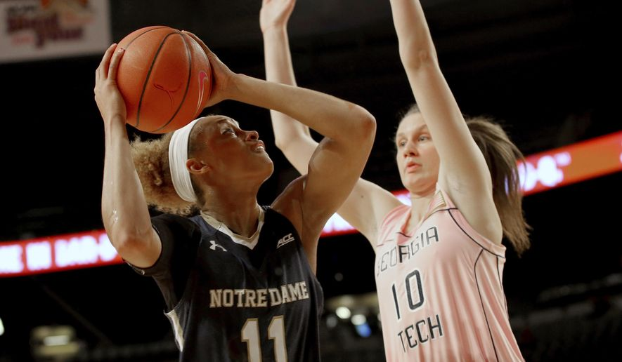 Notre Dame forward Brianna Turner (11) looks to shoot around Georgia Tech forward Katarina Vuckovic (10) in the first half of an NCAA college basketball game in Atlanta, Thursday, Feb. 19, 2015. (AP Photo/Todd Kirkland)