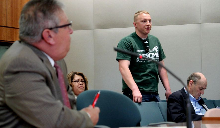 Correctional officer Robert Darnell, standing, testifies in support of legislation that calls for compensation for officers involved in the 1980 riot at the Penitentiary of New Mexico during a House committee hearing in Santa Fe, N.M., on Thursday, Feb. 19, 2015. Lawmakers are considering legislation that would compensate the handful of surviving correctional officers who were at the prison when the riot erupted and suffered from post-traumatic stress disorder as a result. (AP Photo/Susan Montoya Bryan)