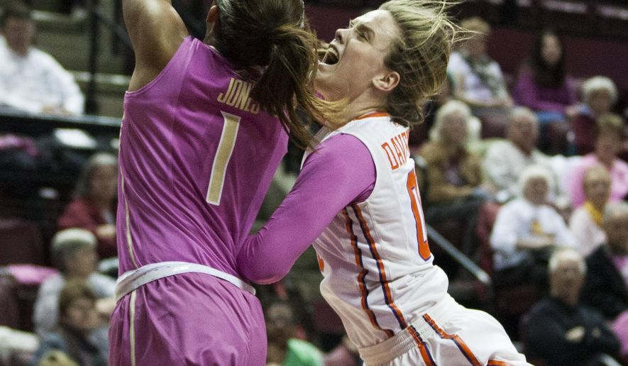 Florida State guard Morgan Jones, left, blocks a shot by Clemson's Shelbie Davenport in the first half of an NCAA college basketball game in Tallahassee, Fla., Thursday, Feb. 19, 2015.  (AP Photo/Mark Wallheiser)