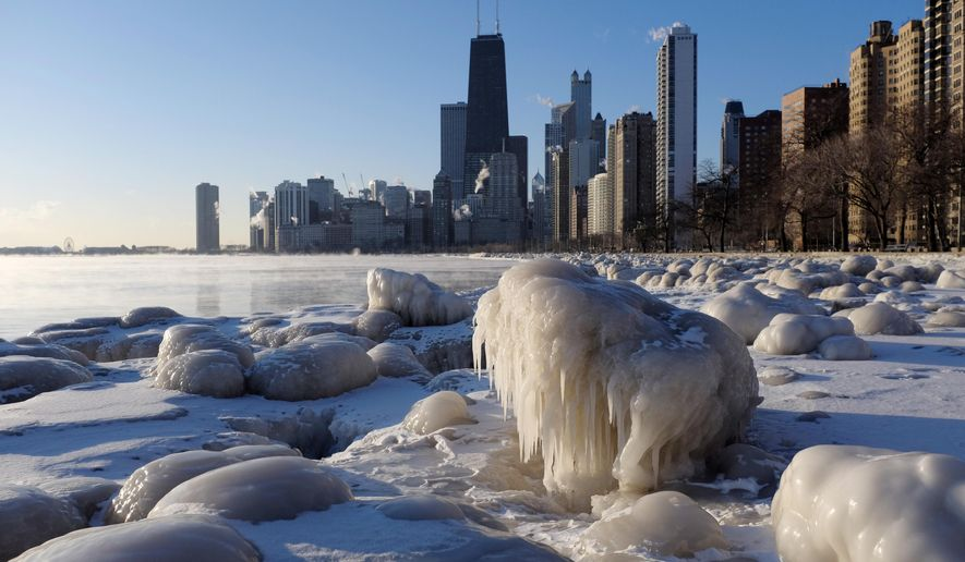 Ice forms along the shore of Lake Michigan, Thursday, Feb. 19, 2015, in Chicago. Temperatures have dipped to as low as -13 in parts of Illinois with wind chills forecast to fall to between 20 and 30 degrees below zero. (AP Photo/Kiichiro Sato)