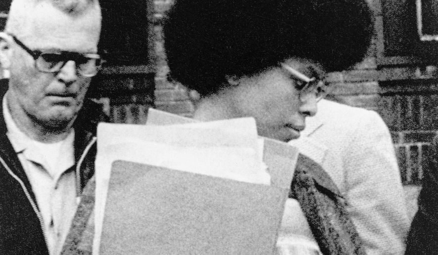 Joanne Chesimard, member of the Black Panther Party and Black Liberation Army, leaves Middlesex County courthouse in New Brunswick, N.J. on April 25, 1977. Now known as Assata Shakur, Chesimard was convicted in 1977 of killing a New Jersey state trooper four years earlier, and was sentenced to life in prison but escaped and wound up in Cuba in the 1980s where she continues to reside. (Associated Press) **FILE**