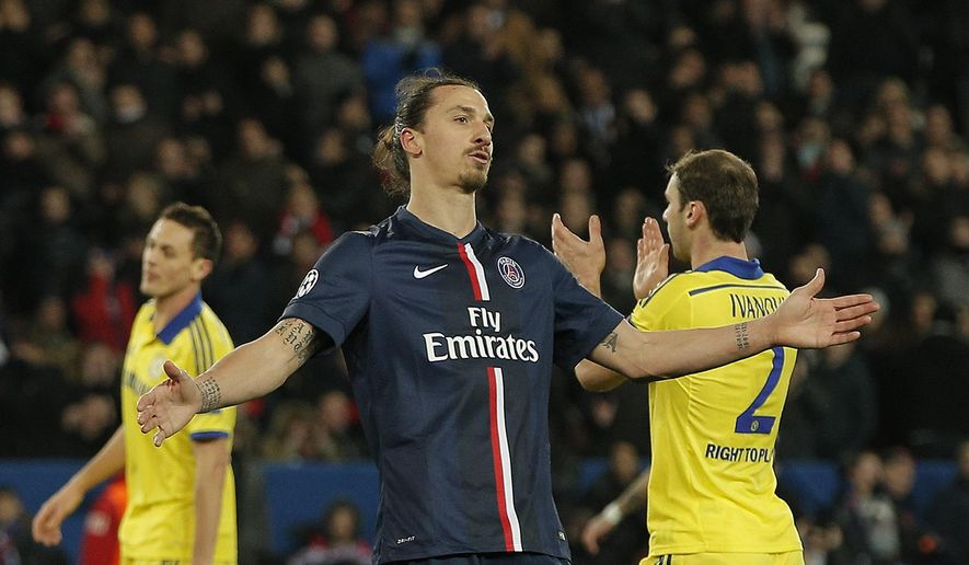 PSG's Zlatan Ibrahimovic reacts after going close to scoring during the Champions League round of 16 first leg soccer match between Paris Saint Germain and Chelsea at the Parc des Princes stadium in Paris, France, Tuesday, Feb. 17, 2015. (AP Photo/Christophe Ena)