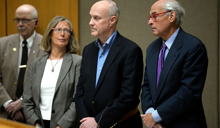 Robert Dellinger stands between his attorneys Lucy Karl and Steven Gordon in Grafton County Superior Court in North Haverhill, N.H., on Thursday, Feb. 19, 2015. Dellinger, a former Fortune 500 executive on Thursday admitted that he killed a pregnant woman, her fiance and their fetus in what he called a failed suicide attempt when he drove his pickup truck across a highway median into oncoming traffic. (AP Photo/Valley News, Jennifer Hauck)