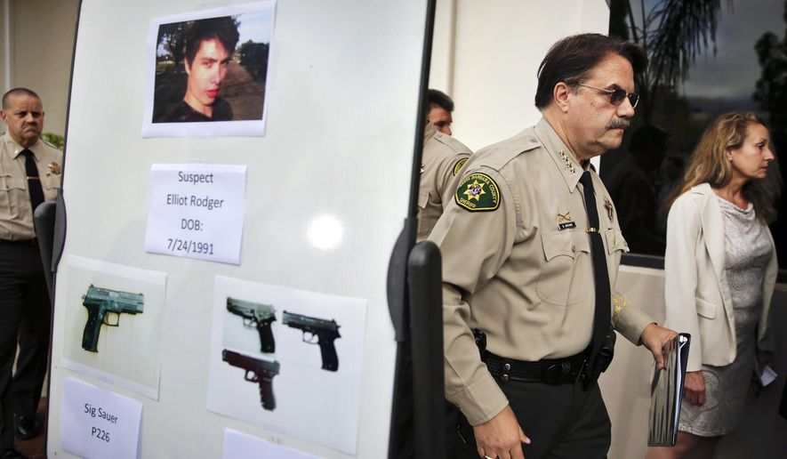 FILE- In this May 24, 2014, file photo, Santa Barbara County Sheriff Bill Brown, right, walks past a board showing the photos of gunman Elliot Rodger and the weapons he used in the mass shooting that took place in Isla Vista, Calif., after a news conference in Santa Barbara, Calif. Authorities concluded that Rodger, who killed six people and injured 13 others near the University of California, Santa Barbara, last year acted alone. The Sheriff's Office released a report Thursday, Feb. 19, 2015, on its eight-month investigation into the massacre.(AP Photo/Jae C. Hong,File)